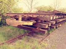 Wagon with extracted old railways. Concrete and wooden sleepers with rail rods Royalty Free Stock Image