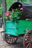 Wagon with Flowers. A vintage style green wagon with pretty pink flowers in it Stock Images