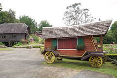Wagon at the German Museum at Frutillar, Chile. Wagon and traditional house at the German Museum a Frutillar, a town in Southern Chile in the Los Lagos Region on Royalty Free Stock Photo