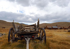 Wagon in ghost town. This old wagon looks great in front of the dramatic sky Stock Photography