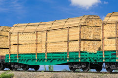 Wagon laden with boards. On the background blue sky stock photo
