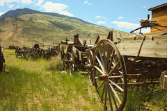 Wagon line. Line of old wooden wagons in hills of wyoming Royalty Free Stock Image