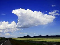 Wagon Mound Cloud. Beautiful perspective landscape captured underneath an amazing cloud which is actually pointing the the focal point on the horizon. My father Royalty Free Stock Image