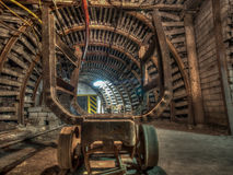 Wagon. An old and ruined wagon for transporting coal in a coal mine tunnel Stock Photo
