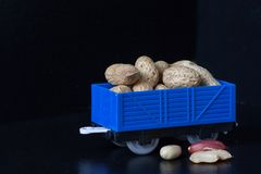 Wagon with of peanut beans. Toy freight wagon. Organic Healthy Beans. Wagon with of peanut beans. Toy freight wagon. Close-up Peanut royalty free stock image