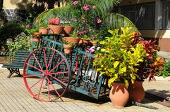 Wagon and Plants. Wagon and Vases with Plants on a Garden Stock Photography