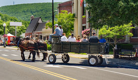Wagon Ride in Clifton Forge, Virginia, USA. Clifton Forge, VA – June 3rd: Festival visitors enjoy a carriage ride at the annual Alleghany Highlands royalty free stock images