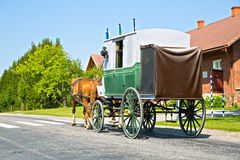 Wagon on road is moving by horses Royalty Free Stock Photos