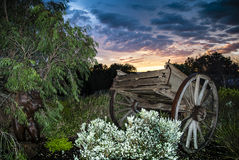 Wagon Sunrise. Sunrise featuring an old horse drawn wagon in the foreground Stock Images