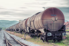 Wagon-tanks waiting for depart. Romantic view of the rail loading composition Royalty Free Stock Images