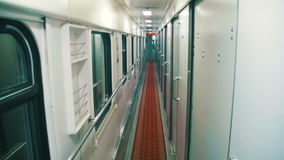 Wagon Train Compartment. Sleeping car of a passenger train. Corridor inside the train car stock footage