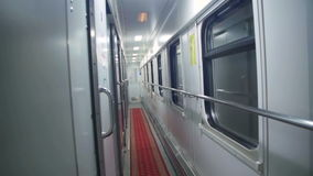 Wagon Train Compartment. Sleeping car of a passenger train. Corridor inside the train car stock footage