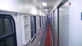 Wagon Train Compartment. Sleeping car of a passenger train. Corridor inside the train car stock video