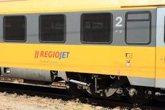 Wagon of train of RegioJet. Yellow and grey wagon of train of private railroad company RegioJet - Student Agency Stock Photo