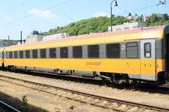 Wagon of train of RegioJet. Yellow and grey wagon of train of private railroad company RegioJet - Student Agency Stock Images
