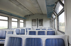 Wagon trains inside. Empty, goes along the field, blue seats Stock Image