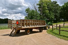 Wagon used as a people hauler. A wagon known as a people hauler is hooked to a tractor and is empty of passengers Royalty Free Stock Photo