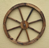 Wagon Wheel. A decorative wagon wheel isolated on a wall stock images