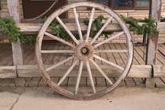 Wagon Wheel. Leaning against a fence with a touch of green looks appealing, feels inviting royalty free stock photography
