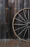 Wagon Wheel. Against barn wall royalty free stock images