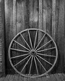 Wagon Wheel. Against wall (black & white stock image