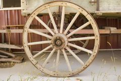 Wagon Wheel. With weeds in front of them Royalty Free Stock Image