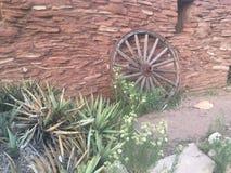 Wagon Wheel. Against desert rocks Stock Photography