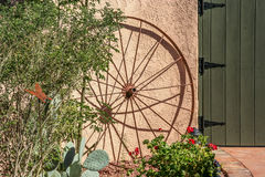 Wagon Wheel Along The Wall Stock Photo