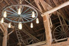 Wagon wheel chandelier. Rustic barn wagon wheel chandelier Royalty Free Stock Photos