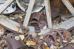Wagon wheel discarded horse shoes pans pile Stock Photos