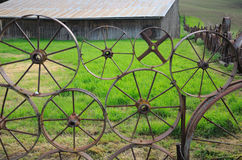 Wagon Wheel Fence and Barn Stock Images