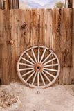 Wagon wheel and fence Royalty Free Stock Photography