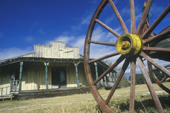Wagon wheel and old building in South TX ghost town Royalty Free Stock Image