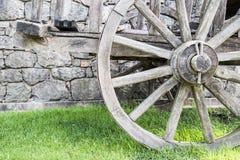 Wagon Wheel. Old wagon wheel made of wood on grass stock image