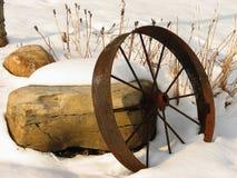 Wagon wheel and rocks Royalty Free Stock Photo