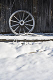 Wagon Wheel in Snow Royalty Free Stock Photos