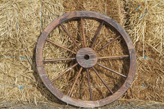 Wagon Wheel on Straw Stock Photo