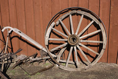 Wagon wheel, tools and plow Stock Images
