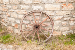 Wagon wheel on the wall Stock Photography