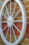 Wagon wheel on wall royalty free stock photography