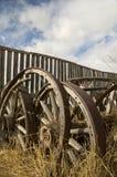 Wagon wheels. Grain wagon wheels in a field Royalty Free Stock Photos