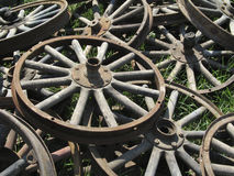 Wagon Wheels. A pile of wagon wheels in the grass Stock Photos