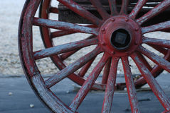 Wagon Wheels. Old wagon wheels with peeling red paint Stock Photos