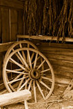 Wagon Wheels and Tobacco. Sepia toned antique wagon wheels and dried tobacco in farm outbuilding Royalty Free Stock Photography