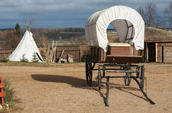 Wagon and wigwam Royalty Free Stock Photo