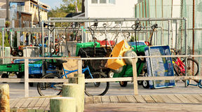 Wagons and bikes wait at the Ferry in Fire Island, NY stock photos