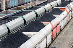 Wagons with coal on railway station. Royalty Free Stock Image