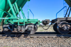 Wagons of a freight train moving fast along the rails Stock Photography
