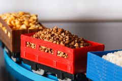 Wagons with grain of buckwheat, rice and peas. Grain Cultures. Selective focus royalty free stock images