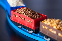 Wagons with grain of buckwheat, rice and peas. Grain Cultures. Selective focus royalty free stock image